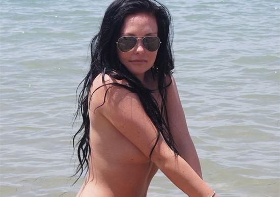 hot-brunette-posing-topless